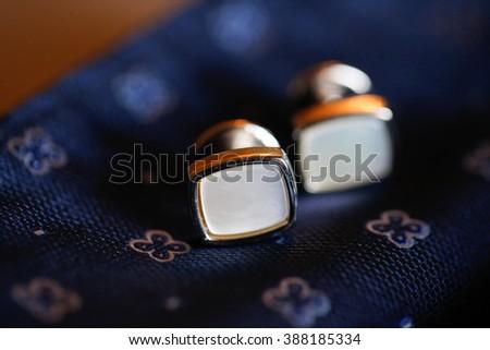 Close up with elegant cufflinks - stock photo