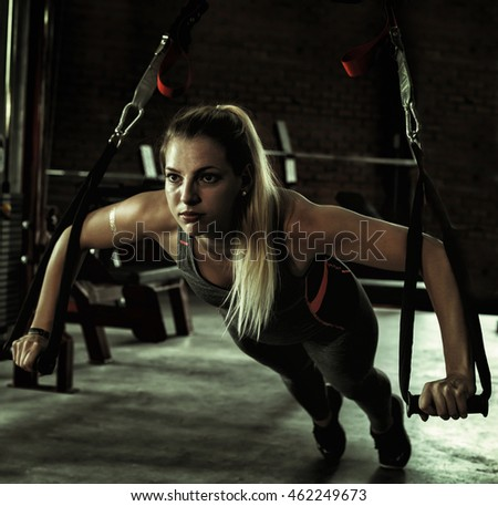 close up woman doing exercises in the gym. Fitness and healthy lifestyle concept