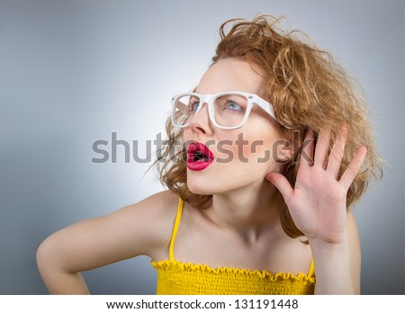Close up woman hand on ear. Listening - stock photo