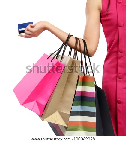 Close up woman hand with many shopping bags and credit card - stock photo
