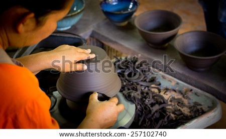 Close up Woman hands of a potter, creating an earthen bowl ceramic of Chiang Rai Artist Thailand - stock photo