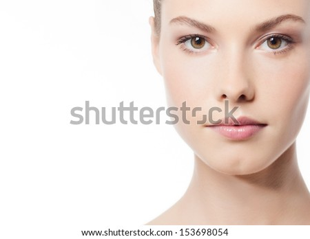 close up  woman portrait  face skin isolated on white looking at camera young - stock photo