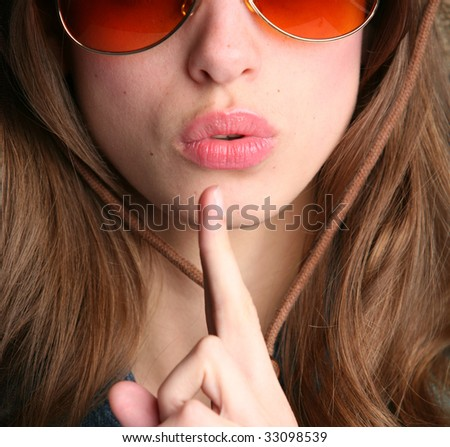 close-up woman portrait with finger near lips