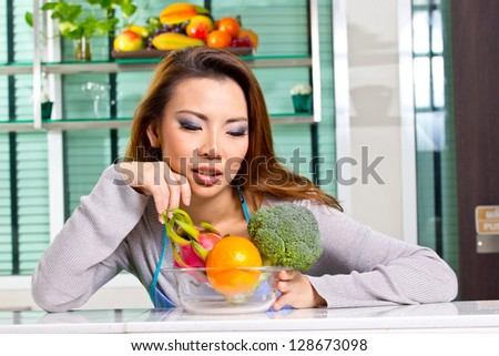 Close up woman preparing materail for do her food in the kitchen - stock photo