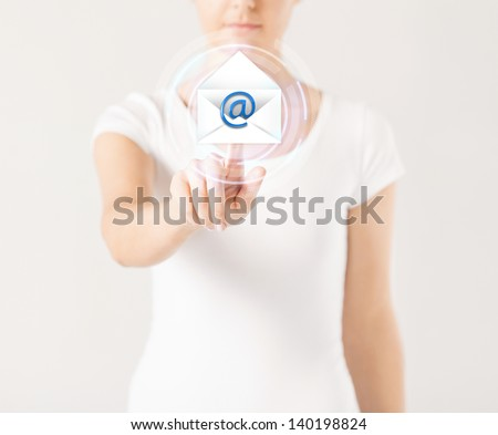 close up woman pressing virtual button with e-mail icon - stock photo