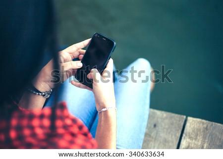 Close up woman using smart phone/Woman using smart phone - stock photo