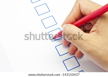 close up women hand and emptychecklist box YES or NO