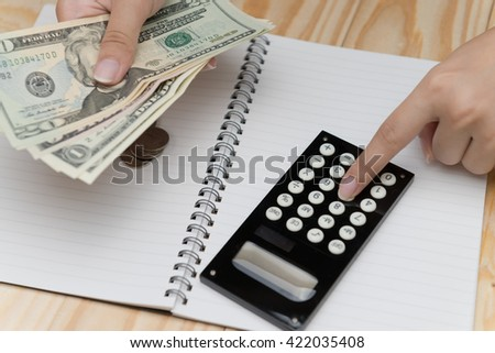 Close up women hands counting and calculate money for saving. - stock photo