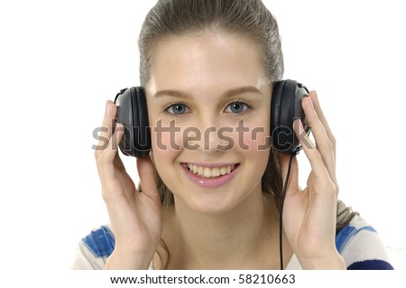 Close up women listening music in headphones