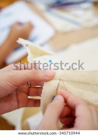 close up women's hand sewing