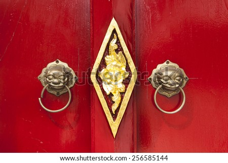 Close-up Wooden door with handle in temple of Thailand - stock photo