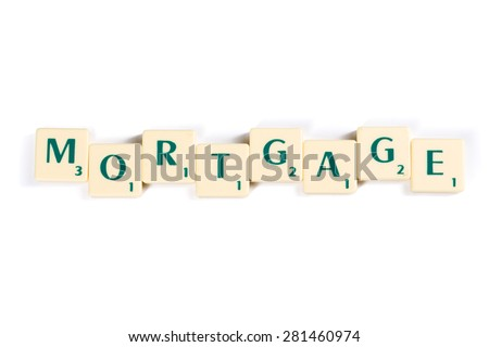 Close up Wooden Scrabble Letter Tiles Forming Mortgage Word Isolated on White Background. - stock photo