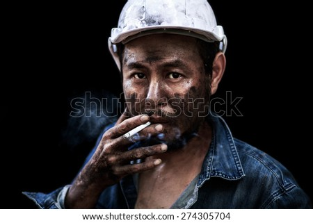 Close up worker man smoking