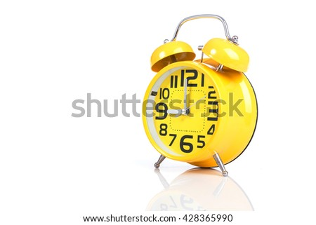 Close up yellow alarm clock isolated on white background - stock photo