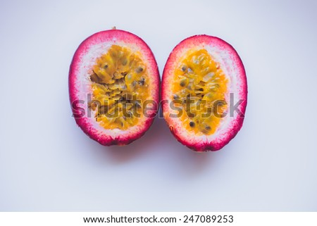 Close up yellow color passion fruit maracuya pulp and seed in small ceramic bowl isolated on white