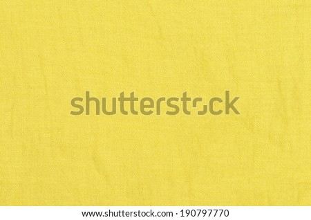close up yellow linen texture background - stock photo