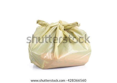 Close up yellow plastic bag isolated on white background - stock photo