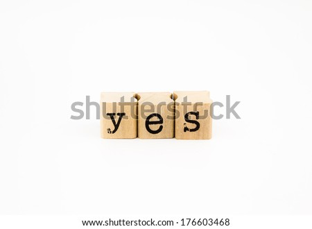 Close-up 'yes' wording isolated on a white background. - stock photo