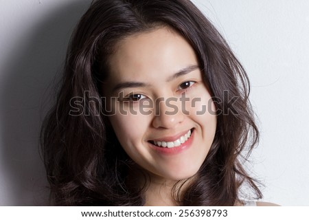 Close up young Asian woman with smiley face.