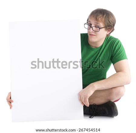 Close up Young Man Wearing Eyeglasses Sitting on the Floor with White Empty Board, Emphasizing Copy Space. Isolated on White Background. - stock photo