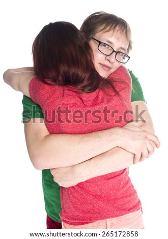 Close up Young White Couple Embracing Each Other So Close While the Guy is Smiling at the Camera, Isolated on White Background. - stock photo