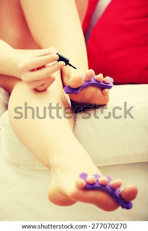 Close up young woman doing a pedicure. - stock photo