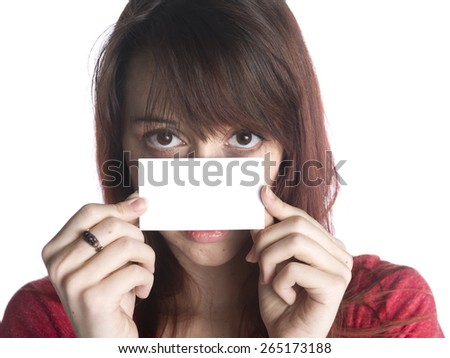 Close up Young Woman Holding an Empty White Greeting Card Close to her Face While Looking at the Camera. Isolated on White Background. - stock photo