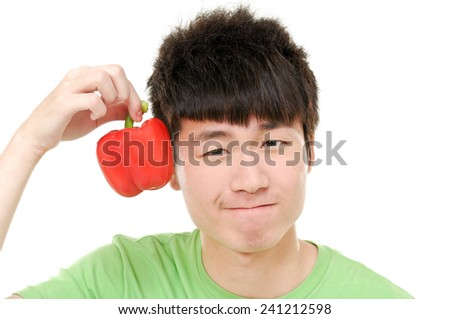 Close up young woman holding red paprika