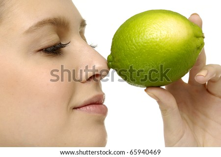 Close up young woman with fresh lime, - stock photo