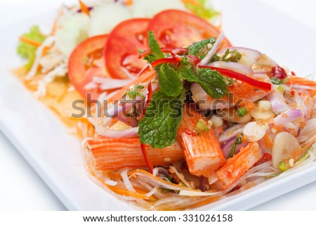 close up yum crab stick with mix egg of prawn on white plate, Thai style