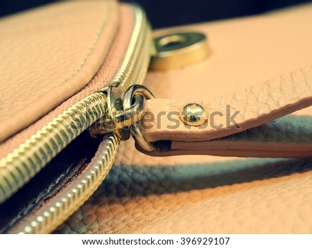 Close up zipper of leather bag