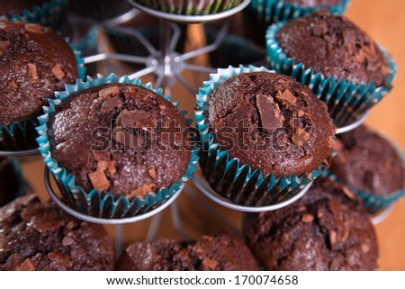 close-ups of chocolate muffins - sweet food - stock photo