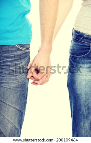 Close ups of couple hands - stock photo