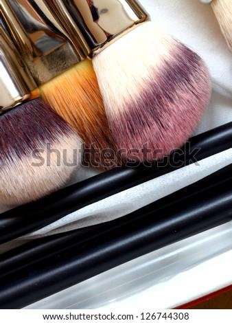 close-ups of make-up brushes - beauty treatment - stock photo
