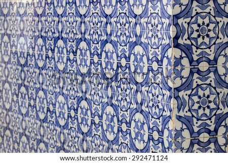 Close view detail of the corner of a building with portuguese azulejos. - stock photo
