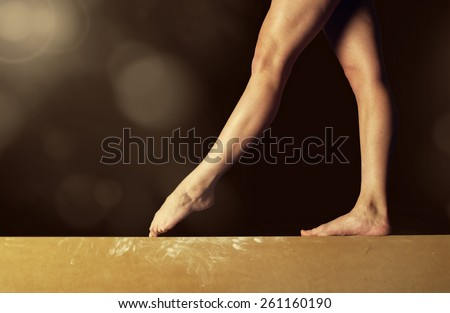 Close view of a Gymnast legs on a balance beam - stock photo