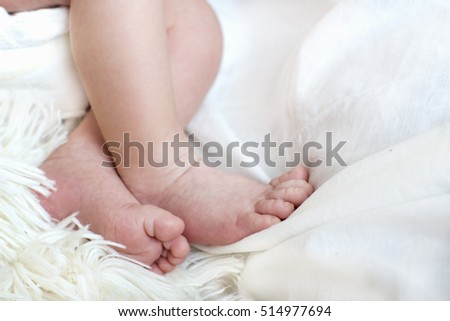 Close view of baby's feet in a blurred background