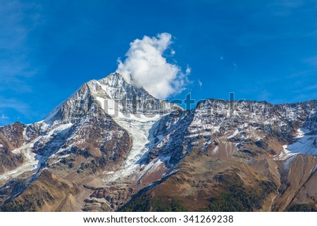 Close view of Bietschhorn in canton Wallis to the south of the Bernese Alps in Switzerland. its northeast and southern slopes are part of the Jungfrau-Aletsch Protected Area as UNESCO World Heritage. - stock photo