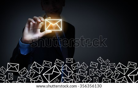 Close view of businessman taking email sign with fingers - stock photo