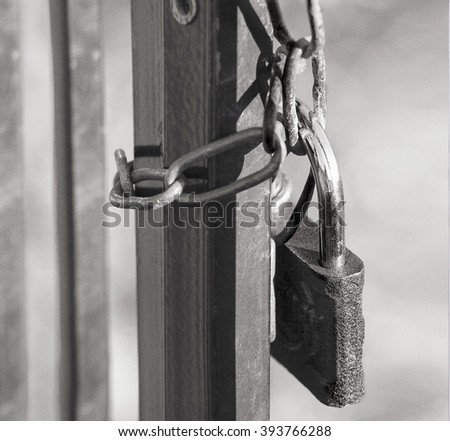 Close view of closeup  gates with old lock and chain - stock photo