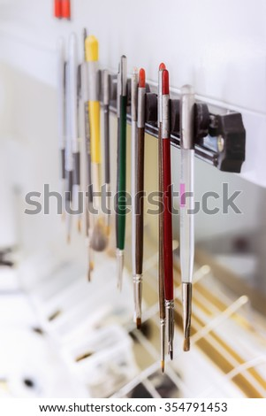 Close view of colorful various brush tools in dental clinic