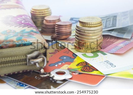 Close view of euro coins, euro banknotes, wallet and  cards   - stock photo