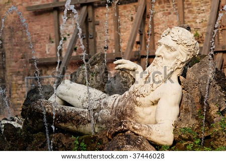 Close view of Poseidon statue in Heidelberg, Germany. Sunset warm light. - stock photo