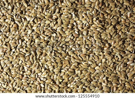 Close view of raw flaxseed with shadows highlighted. - stock photo