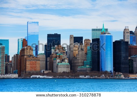 Close view of skyscrapers from water of Gudson harbor in New York, USA at winter  - stock photo