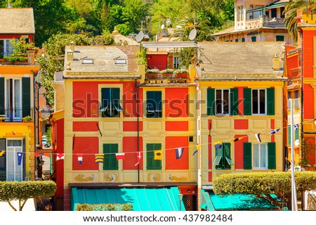 Close view of the colorful houses in Portofino, an Italian fishing village, Genoa province, Italy. A vacation resort with a picturesque harbour and with celebrity and artistic visitors.