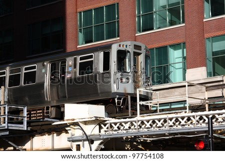 Close view of the EL overhead commuter train in Chicago - stock photo