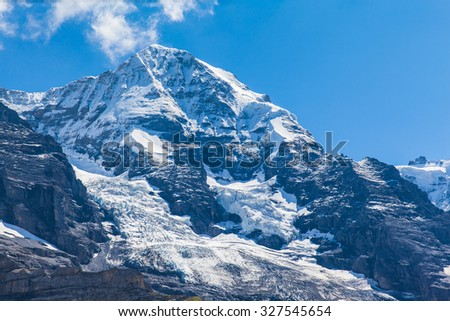 Close view of the famous peak Monch of the swiss Alps on Bernese Oberland in Switzerland. It is one of the main summits of the Bernese Alps,between southern canton Bern and northern canton Valais.