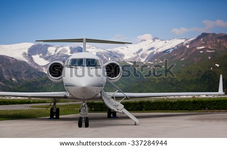 Close view of the front of a private jet - stock photo