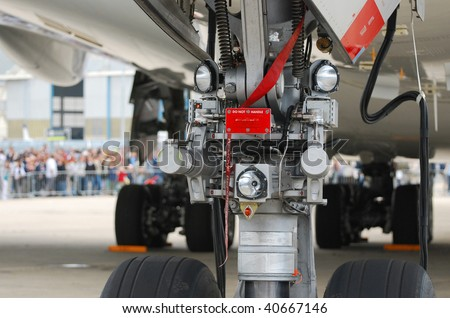 Close view of the nosewheel assembly of a very large passenger airplane - stock photo
